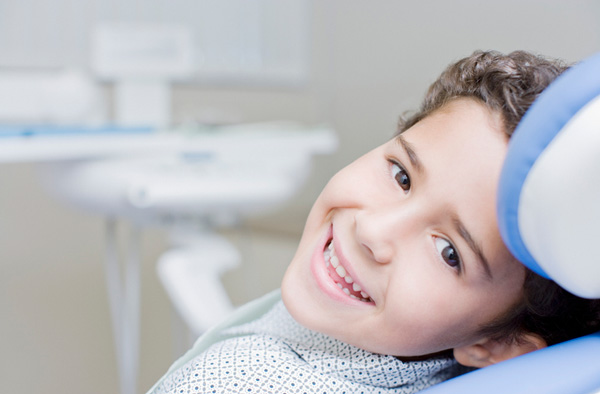 Young boy smiling with healthy teeth after getting dental sealants at Watermark Dentistry in Normandy Park, WA